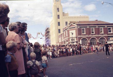 Crowds watch the Centennial Parade