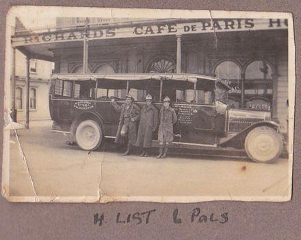 Bus parked in front of Cafe de Paris