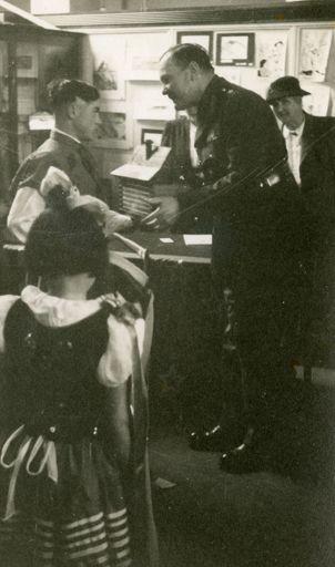 Governor General, Lieutenant-General Sir Bernard Cyril Freyberg, receiving gift from Polish children