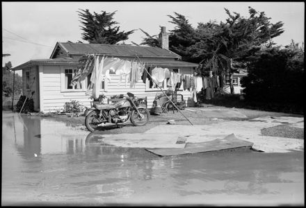 """Cleaning up After the Devastation"" - Flooding"