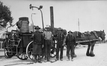 City workmen and road tarring machine