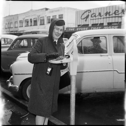 """""""A Finger in the Works"""" Meter Maid Checking Parking Meter."""