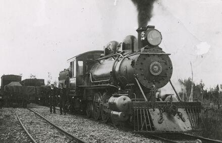 Driver and guard with Wellington Manawatu Railway Company No. 5 engine