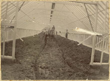 Preparing glass house for planting, Nairn Estate, College Street