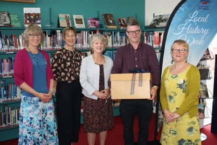 Massey University Library presenting manuscripts to Palmerston North City Libraries