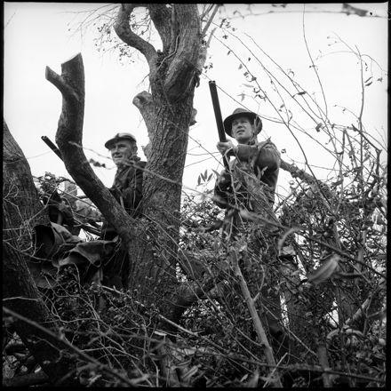 """Successful Morning Shoot"" [Two Men Hunting in Brush]"