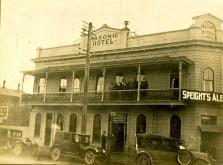 Group on the verandah of the Masonic Hotel