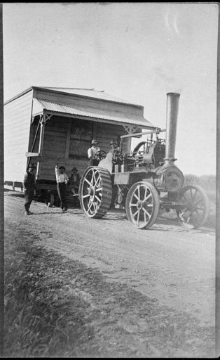 Traction Engine Hauling a section of a Farmhouse
