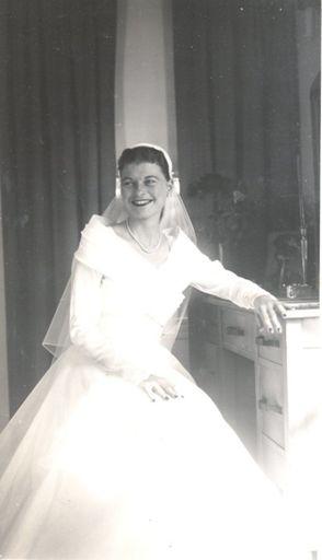 Ida Ann in her wedding dress, sitting at Mrs Lett's dressing table, 1951.