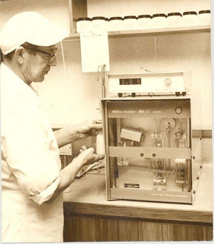 Mr Becht, butterfat testing unit, Kuku Dairy Factory, 1971