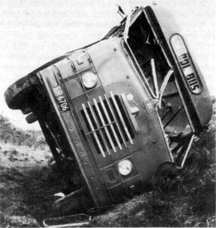 Foxton school bus on its side, 1965