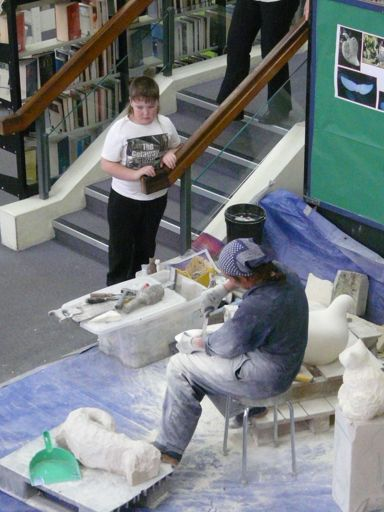 Wendy Hodder sculpting in the library