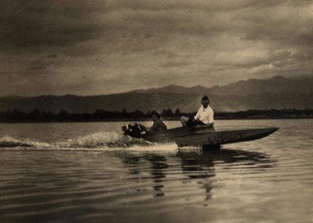 """James Hughes in his speedboat """"Comet"""",  1933"""