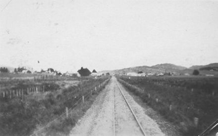View from rear of train after leaving an unidentified rural town, 1927 or 1928