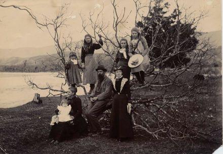 Family Group Beside River
