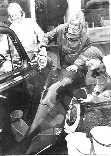 Three Young Women Washing  A Car