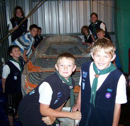 Sea Scouts repairing boat