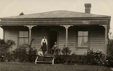 Three People on Verandah of Robinson Home, December 1910