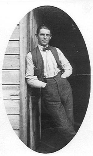 Unidentified Man Leaning in Doorway