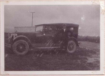 Mr Gimblett standing beside his car (Hudson Super Six), 1924