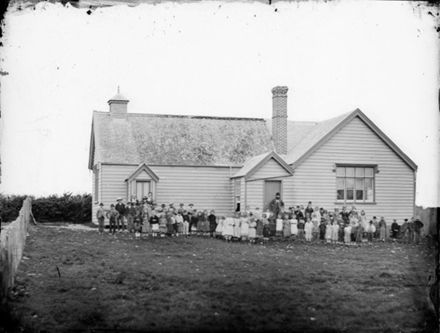 Foxton schoolhouse, pupils and teachers, ca 1870s