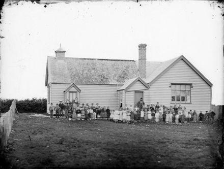 Foxton schoolhouse, pupils and teachers, ca 1870s