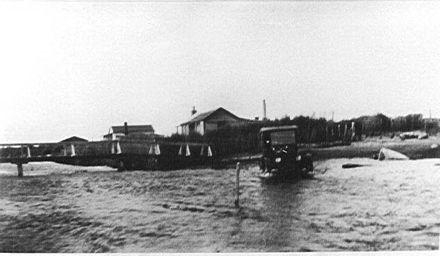 Car fording across Hokio Stream, 1920s
