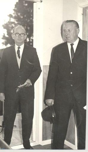 2 men (unidentified) standing in doorway
