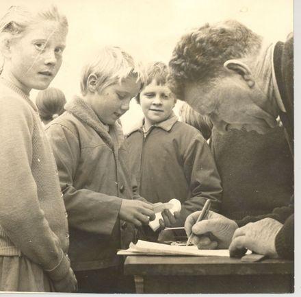 Man (unidentified) & primary school children (unidentified)